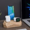 wooden charging dock with Apple devices
