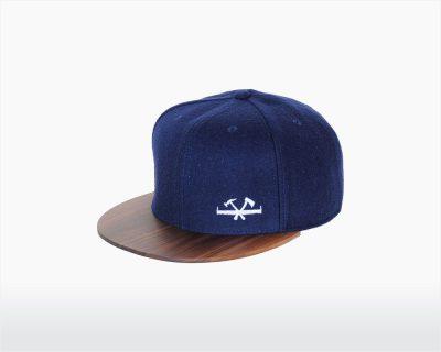 wooden cap with walnut brim and navy blue wool glueim two o on wooden amsterdam.jpg